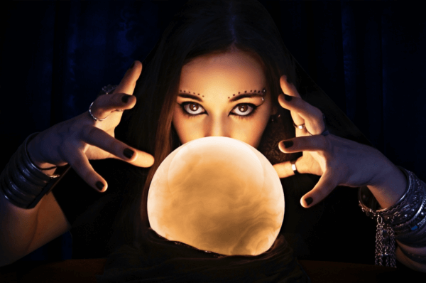 Woman mysteriously looking over crystal ball