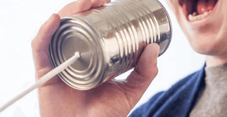 Man speaking into tin can with a string